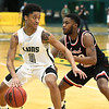 Missouri Southern's Reggie Tharp (0) fights to get past Central Missouri's DJ Anderson (20) during their game on Thursday night at Leggett & Platt.<br /> Globe | Laurie Sisk
