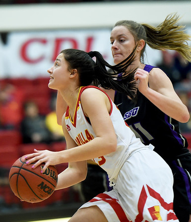 Pittsburg State's Sydnee Crain scores (42) scores as Southwest Baptist's Morgan Henderson (11) defends during their game on Wednesday night at John Lance Arena.<br /> Globe | Laurie Sisk