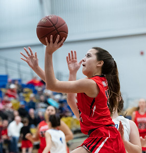 Baxter's Kennedy Krokroskia (12) goes for two points from the baseline during the game against Riverton on Friday night at Riverton High School.