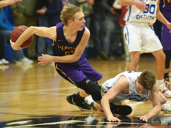 Verona's Kolton Pinkly (21) tries to keep the ball from McAuley's Jacob Price (23) during their game on Friday night at McAuley.<br /> Globe | Laurie Sisk