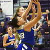 Carthage's Mia Duncan (43) drives the lane as Pittsburg Zoe Pinamonti defends during their game in the opening round of the Bill Hanson Memorial Tournament on Wednesday night at Pittsburg High School.<br /> Globe | Laurie Sisk