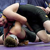 Monett's Dru Guinn, top, battles Nevada's Spencer Hawkins during their 182-lb. match at the Ozark 8 Wrestling Championships on Friday night at Monett High School.<br /> Globe | Laurie SIsk