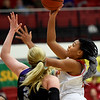 Pittsburg State's Maya Williams scores on Southwest Baptist's Caylee Richardson (3) during their game on Wednesday night at John Lance Arena.<br /> Globe | Laurie Sisk