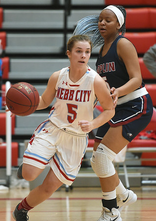 Webb City's Ali Vanzant (5) gets past Joplin's Avery Gage during their game on Tuesday night at Webb City High School.<br /> Globe | Laurie Sisk