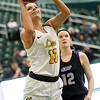 Missouri Southern's Brooke Stauffer (13) gets past Southwest Baptist's Madison Strong (12) for a score during their game on Saturday at Leggett & Platt.<br /> Globe | Laurie Sisk