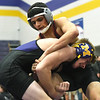 Monett's Karter Brink, front, works to bring down Nevada's Vasant Goswami during their 120-lb. match at the Ozark 8 Wrestling Championships on Friday night at Monett High School.<br /> Globe | Laurie SIsk
