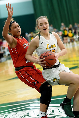 Missouri Southern's Zoe Campbell (10) looks to get past Central Missouri's Kim Crown (45) during their game on Thursday night at Leggett & Platt.<br /> Globe | Laurie Sisk
