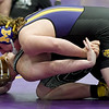 Monett's Harrison Meriman, top, battles Springfield Catholic's Benji Yarnall during their 220-lb. match at the Ozark 8 Wrestling Championships on Friday night at Monett High School.<br /> Globe | Laurie SIsk