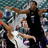 Missouri Southern's Reggie Tharp (0) scores despite a 5-inch difference in heighth as Southwest Baptist's Karim Mouliom (1) defends during their game on Saturday at Leggett & Platt.<br /> Globe | Laurie Sisk