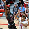 Joplin's Evan Guillory (21) scores over Webb City's Terrell Kabala (1) during their game on Tuesday night at Webb City High School.<br /> Globe | Laurie Sisk