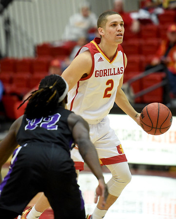 Pittsburg State senior Grant Lozoya (2) looks to get past Southwest Baptist's Godfrey Rolle (22) during their game last week at John Lance Arena.<br /> Globe | Laurie Sisk