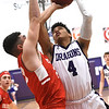 Pittsburg's Gavyn Elkamil (4) drives the lane as Carl Junction's Alex Baker (4) defends during their game in the opening round of the Bill Hanson Memorial Tournament on Wednesday night at Pittsburg High School.<br /> Globe | Laurie Sisk
