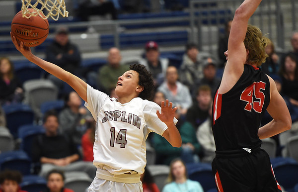 Joplin's Always Wright (14) gets past Jefferson City's Ryan Brooks (45) for a score their game in the first round of the Kaminsky Classic on Thursday night at JHS.<br /> Globe | Laurie Sisk