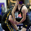 Monett's Ty McCully, right, battles Cassville's Gavin Moore during their 113-lb. match at the Ozark 8 Wrestling Championships on Friday night at Monett High School.<br /> Globe | Laurie SIsk
