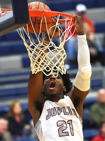 Joplin's Evan Guillory (21) buries a dunk during the Eagles game against Jefferson City in the first round of the Kaminsky Classic on Thursday night at JHS.<br /> Globe | Laurie Sisk