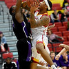 Pittsburg State's Donovan Franklin (3) draws a foul on Southwest Baptist's Karim Mouliom (1) during their game on Wednesday night at John Lance Arena.<br /> Globe | Laurie Sisk