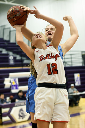 Carl Junction's Shila Winder (12) draws a foul on Chanute's Thea Alschner during their game in opening round of the Bill Hanson Memorial Tournament on Wednesday night at Pittsburg High School.<br /> Globe | Laurie Sisk