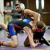 Monett's Elias Barrientas, rear, tries to bring down Seneca's Dane Napier during their 138-lb. match at the Ozark 8 Wrestling Championships on Friday night at Monett High School.<br /> Globe | Laurie SIsk