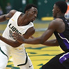 Missouri Southern's Elyjah Clark (15) looks for an open teammate as Southwest Baptist's Tyler Williams (11) defends during their game on Saturday at Leggett & Platt.<br /> Globe | Laurie Sisk