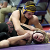 Monett's Gunnar Bradly, top, works to pin Logan-Rogersville's Trenton Graham during their 152-lb. match at the Ozark 8 Wrestling Championships on Friday night at Monett High School.<br /> Globe | Laurie SIsk