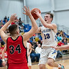 Riverton's Tyler Zustiak (12) shoots for two points from the baseline during their match against Baxter Springs on Friday night at Riverton High School.