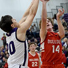 Pittsburg's Payton Cantrell (20) challenges a shot by Carl Junction's Teagan Armentrout (14) during their game in the opening round of the Bill Hanson Memorial Tournament on Wednesday night at Pittsburg High School.<br /> Globe | Laurie Sisk