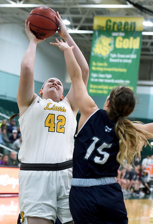Missouri Southern's Jordan Schoenberger (42) puts up a shot as Washburn's Alexis McAfee (15) defends during their game on Wednesday night at Leggett & Platt.<br /> Globe | Laurie Sisk