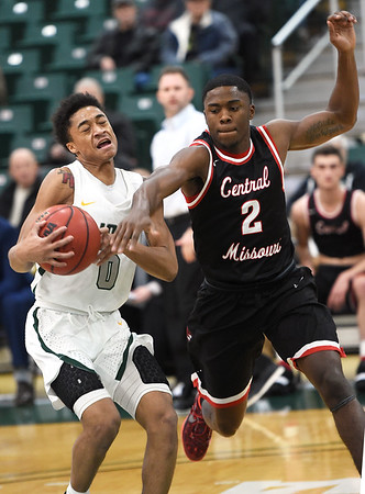 Missouri Southern's Reggie Tharp (0) fights to get past Central Missouri's James Byrd (2) during their game on Thursday night at Leggett & Platt.<br /> Globe | Laurie Sisk