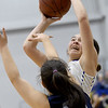 Riverton's Jacy Thomasson shoots over Galena's Kierra Hall (34) during their game on Friday night at RHS.<br /> Globe | Laurie Sisk