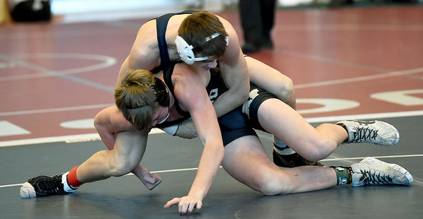 Joplin's Brendan Mynatt, top, battles Neosho's Cade Daniel during their 160 lb. match on Saturday at JHS.<br /> Globe | Laurie Sisk