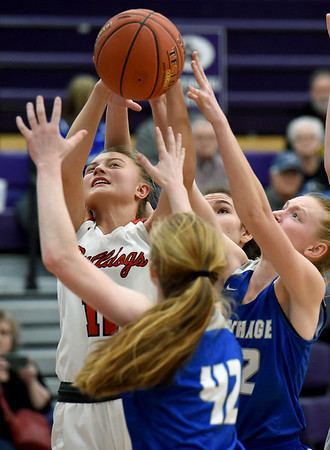 From the left: Carl Junction's Shila Winder battles Carthage's xx xx (42) and Sara Golden for a rebound during their semifinal game of the 2020 Bill Hanson Memorial Tournament on Friday at Pittsburg High School.<br /> Globe   Laurie Sisk