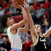 Webb City's Mekhi Garrard (0) shoots a jumper as Cassville's Kel Wilson (1) defends during their game on Friday night at the Cardinal Dome.<br /> Globe | Laurie Sisk