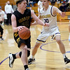 Golden City's Lane Dunlap (32) looks for a lane to the basket as Thomas Jefferson's Drew Goodhope (30) defends during their game on Thursday night at Thomas Jefferson.<br /> Globe | Laurie Sisk