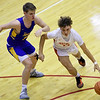 Carl Junction's Trentyn Lehman, right, tries to get past Francis Howell's Drew Lohmar during their game in the opening round of the Kaminsky Classic on Thursday at JHS.<br /> Globe | Laurie Sisk
