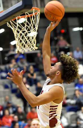 Joplin's Zach Westmoreland lays in a transition bucket during the Eagles game against Webb City  on Tuesday night at Kaminsky Gymnasium.<br /> Globe | Laurie Sisk