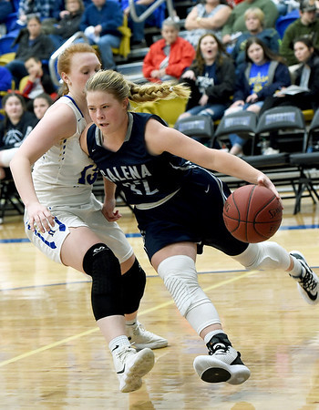 Galena's Riley McNemar (32) tries to get past Riverton's Daphnii Parker (13) during their game on Friday night at RHS.<br /> Globe   Laurie Sisk