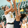 Missouri Southern's Madi Stokes (31) shoots over Newman's Faith Mason-Vestal (24) during their game on Saturday at Leggett & Platt.<br /> Globe | Laurie Sisk