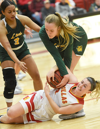 Pittsburg State's Kaylee DaMitz (2) battles Missouri Southern's Zoe Campbell for the ball as MSSU's Kaiulani Jones (3) looks on during their game on Saturday at PSU.<br /> Globe | Laurie SIsk