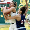 Missouri Southern's Madi Stokes (31) battles Newman's Faith Mason-Vestal (24) for a loose ball during the first half of their game on Saturday at Leggett & Platt.<br /> Globe | Laurie Sisk