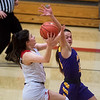 Carl Junction's Jessa Hylton makes a layup around Monett's Ashley Kurima during Monday's game in Carl Junction.<br /> Globe | Roger Nomer