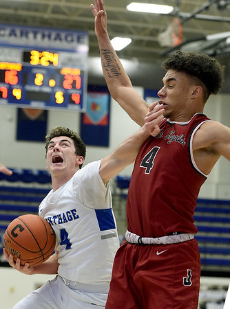 Carthage's Tyler Mueller drives to the basket as Joplin's Dakarai Allen defends during their game on Tuesday night at CHS.<br /> Globe | Laurie Sisk