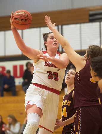Carl Junction's Katie Scott makes an interior pass against the Girard defense during Monday's game in Carl Junction.<br /> Globe | Roger Nomer