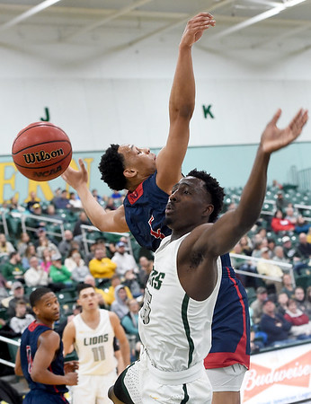 Missouri Southern's Elyjah Clark (15) battles Newman's Madison Birnbaum (5) for a rebound during the first half of their game on Saturday at Leggett & Platt.<br /> Globe   Laurie Sisk