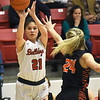 Carl Junction's Jessa Hylton (21) hits a three pointer over the outstretched arms of Republic's Kaemtn Berekemeier (24) during their game on Thursday night at CJHS.<br /> Globe | Laurie Sisk