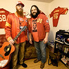 Brothers Derek and Joe Rhattigan stand in their Seneca apartment on Tuesday. The duo's ode to the Kansas City Chiefs has gone viral on YouTube.<br /> Globe | Laurie SIsk