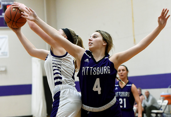 Pittsburg's Cheyanne Hunt (4) and Blue Valley Northwest's Evie Vitali (2) vie for a rebound during their consolation semifinal game of the 2020 Bill Hanson Memorial Tournament on Friday at Pittsburg High School.<br /> Globe | Laurie Sisk
