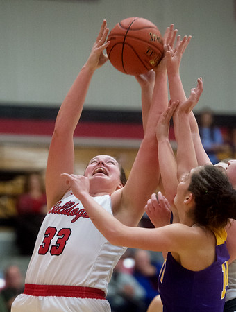Carl Junction's Katie Scott pulls away a rebound from Monett's Kelsey Dalton during Monday's game in Carl Junction.<br /> Globe | Roger Nomer