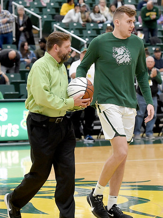 Missouri Southern's Cam Martin is honored for surpassing the 1,000 career points mark before the start of the Lions game against Newman University on Saturday at Leggett & Platt. Also pictured is Missouri Southern Director of Athletics Jared Bruggeman.<br /> Globe | Laurie Sisk