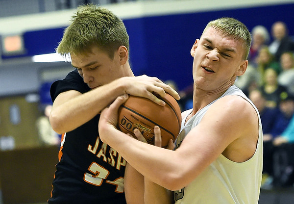 From the left: Jasper's xx (34) and College Heights' xx (30) battle for a rebound  during their game on Friday night at Ozark Christian College.<br /> Globe | Laurie Sisk