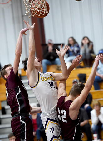 Thomas Jefferson's Dylan Dean-Heck (14) splits Wheaton defenders Zac Leverich (30) and Jack Mitchell (32) during their game on Tuesday night at TJ.<br /> Globe | Laurie Sisk